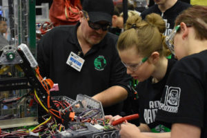 team of 4-Hers working on robotics