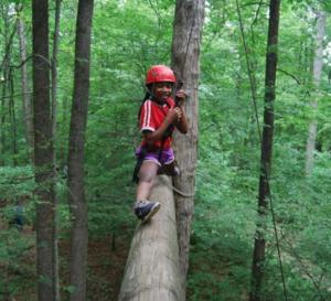 Child walking across log